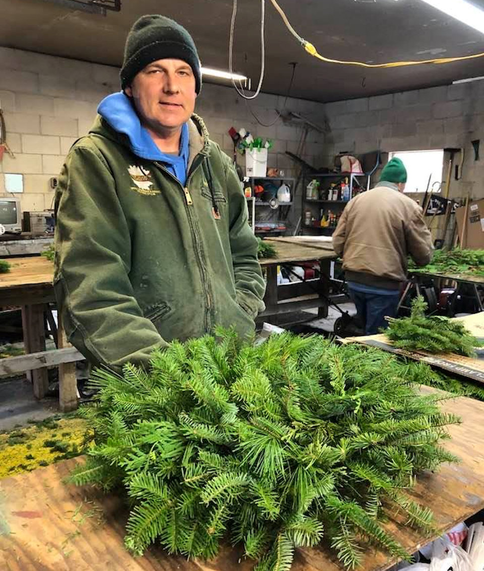 Man making wreath