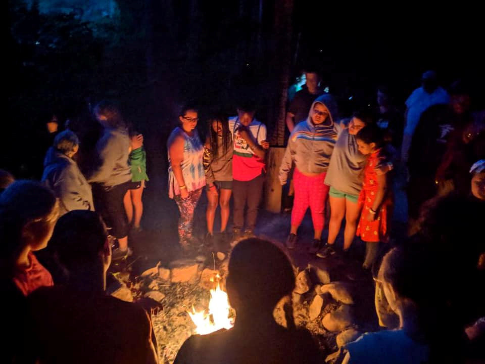 Youth at fire bowl at Wesley Woods Camp