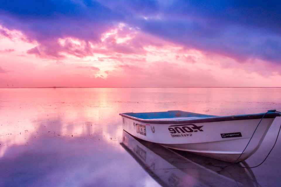 Boat in the water at dawn inviting laity to board