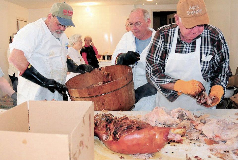 Men in kitchen working on bbq