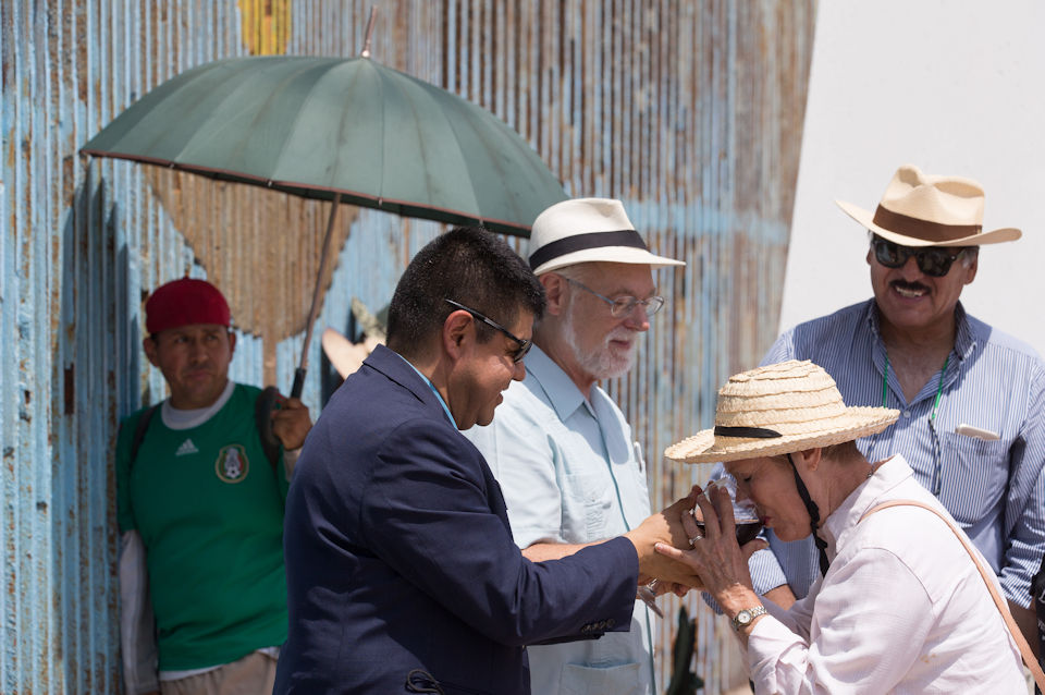 People share the sacrament at the US-Mexico border