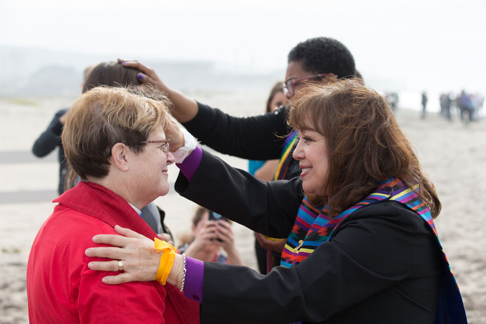 People blessed during protest at the border.