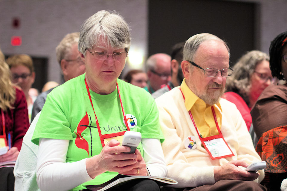 Diana and Duane Miller use electronic voting devices at The Michigan Conference.