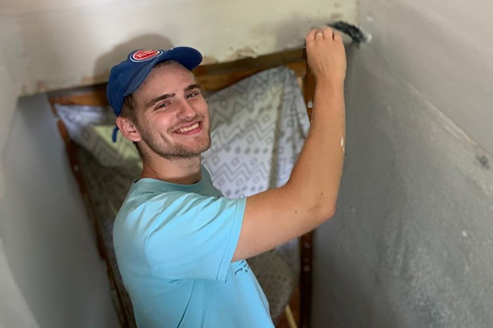 Young man painting during his summer vacation for Appalachia Service Project