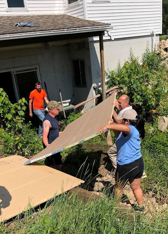 Volunteers work in flood recovery in Wisconsin
