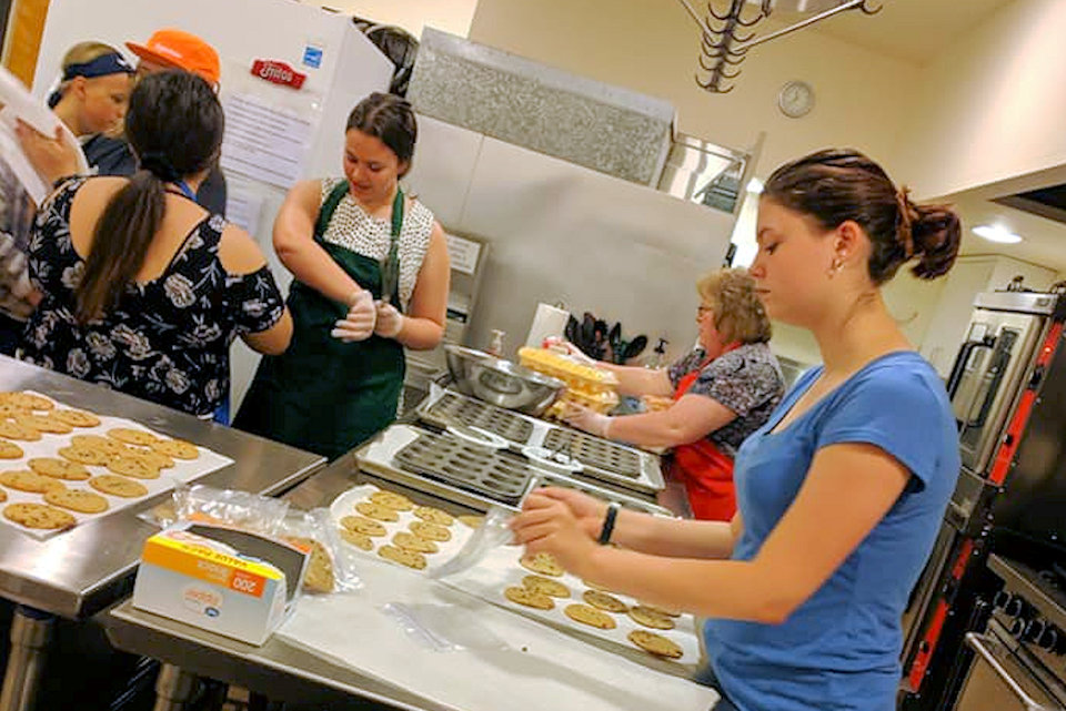 Youth bake cookies for Youth 2019 trip