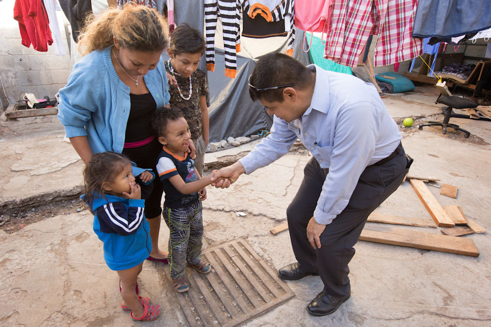 Pastor seeing and greeting children and parents at the border