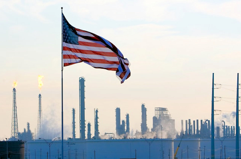 Flag over oil refineries