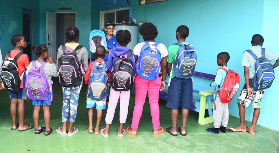 Children in Bahamas receive back packs from Rotary Club