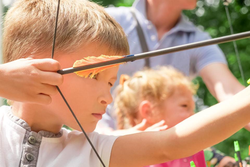 Boy aiming at a target