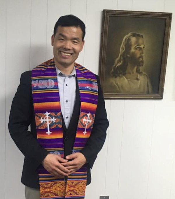 Pastor Cloud Pyo and the stole given by his congregation