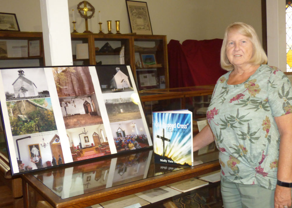 Molly Shaffer with historic photos of the church.