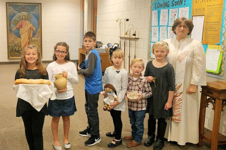 Pastor LuAnn Rourke with the children of Port Huron First UMC