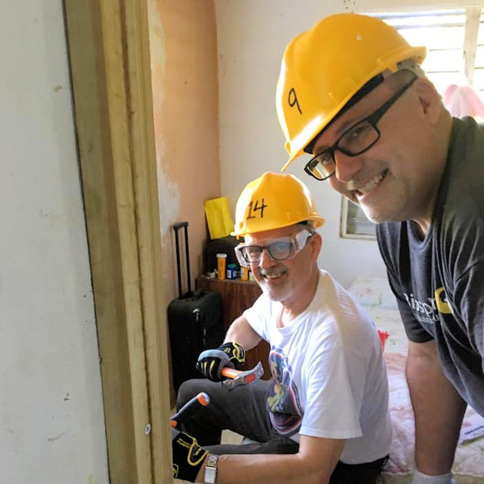 Two men working on home repair in Puerto Rico