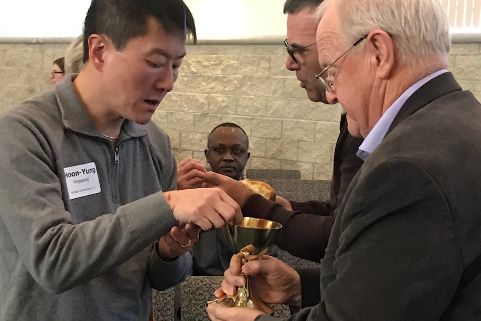 NCJ delegate Hopgood receives communion