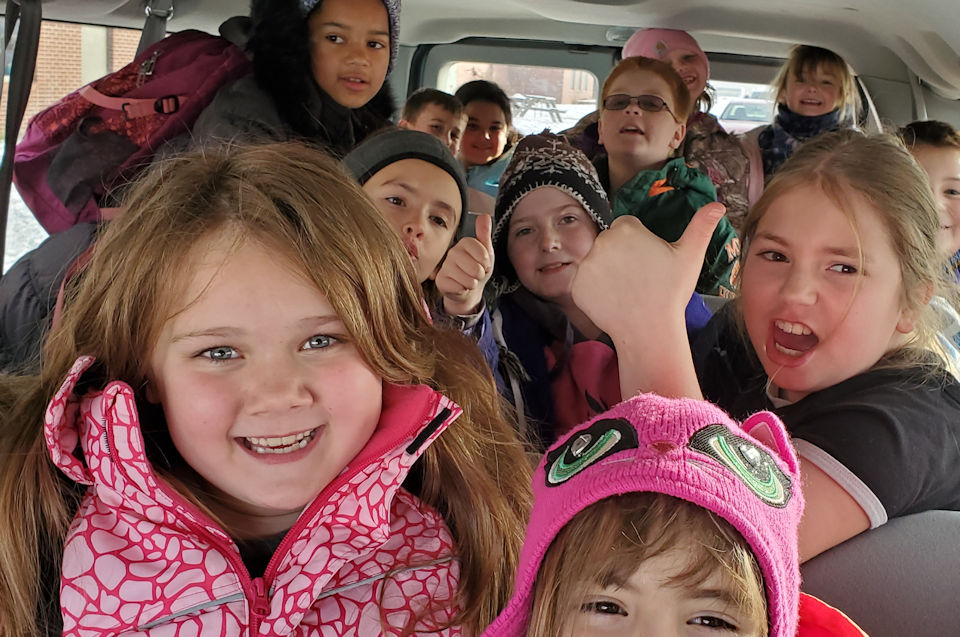 Pickford students enjoy a ride in the van