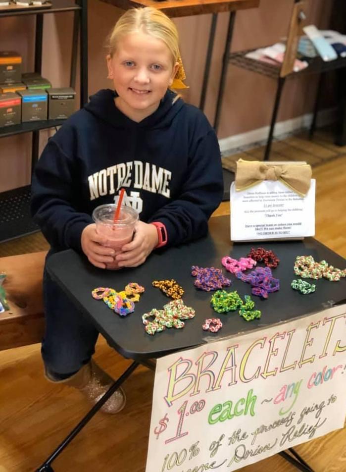 Girl selling bracelets