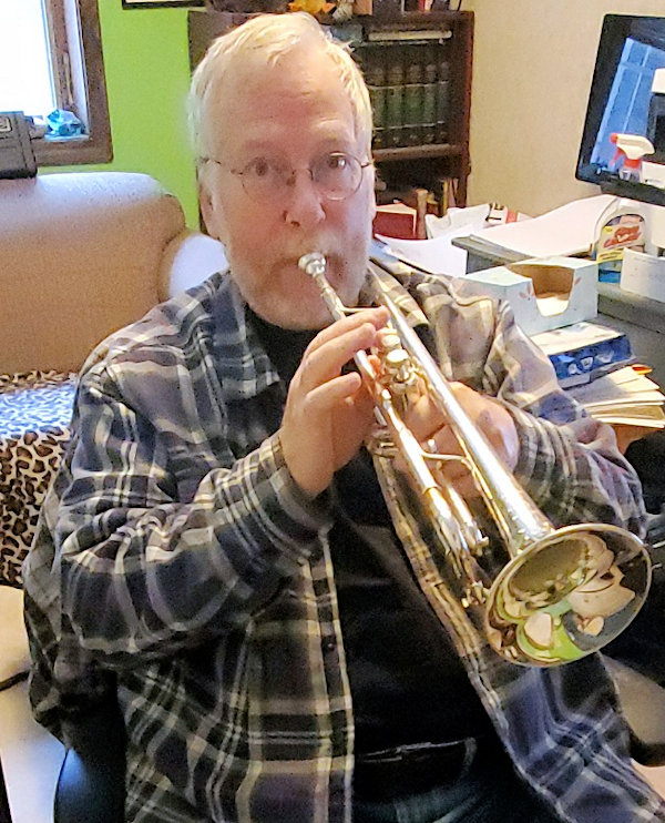 Paul gives a toot on his trumpet