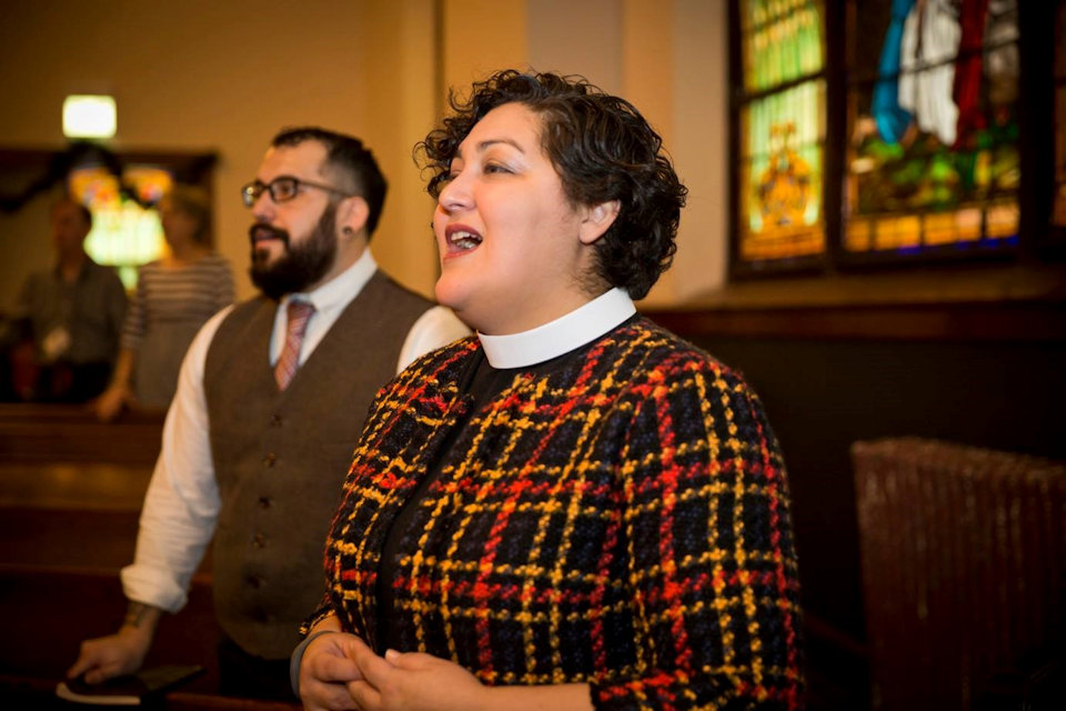 Chaplain April Gutierrez singing