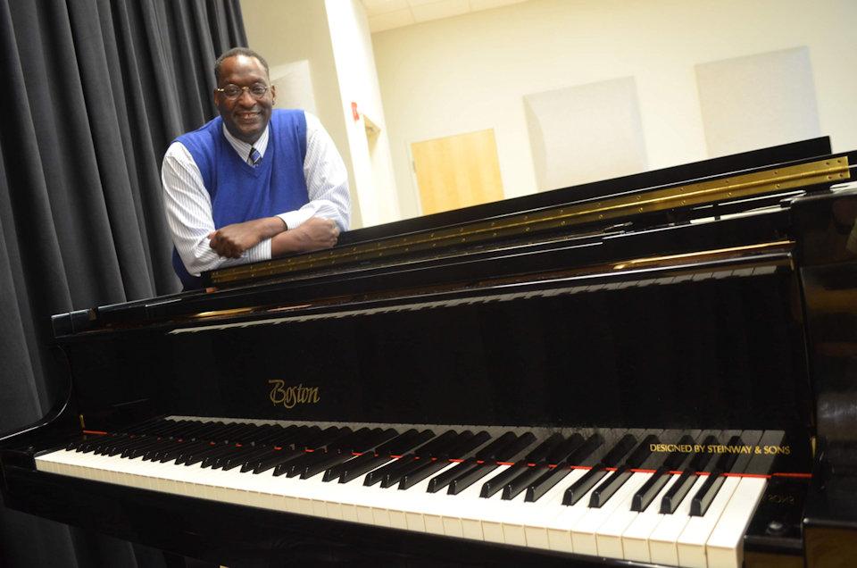 Musician James Story at piano