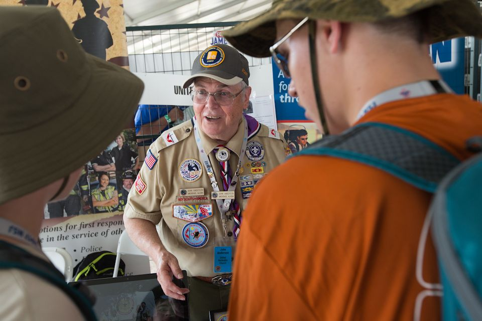 Boy Scout leader talking to scouts
