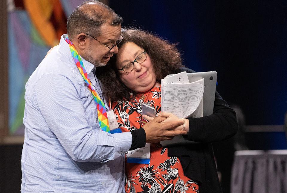 Two delegates overcome loss with love