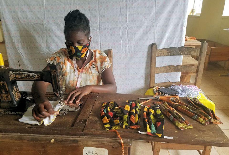 Heroes in Haiti sewing masks