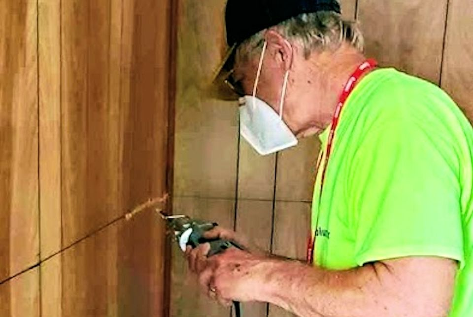 Early responder works on wall in Gladwin