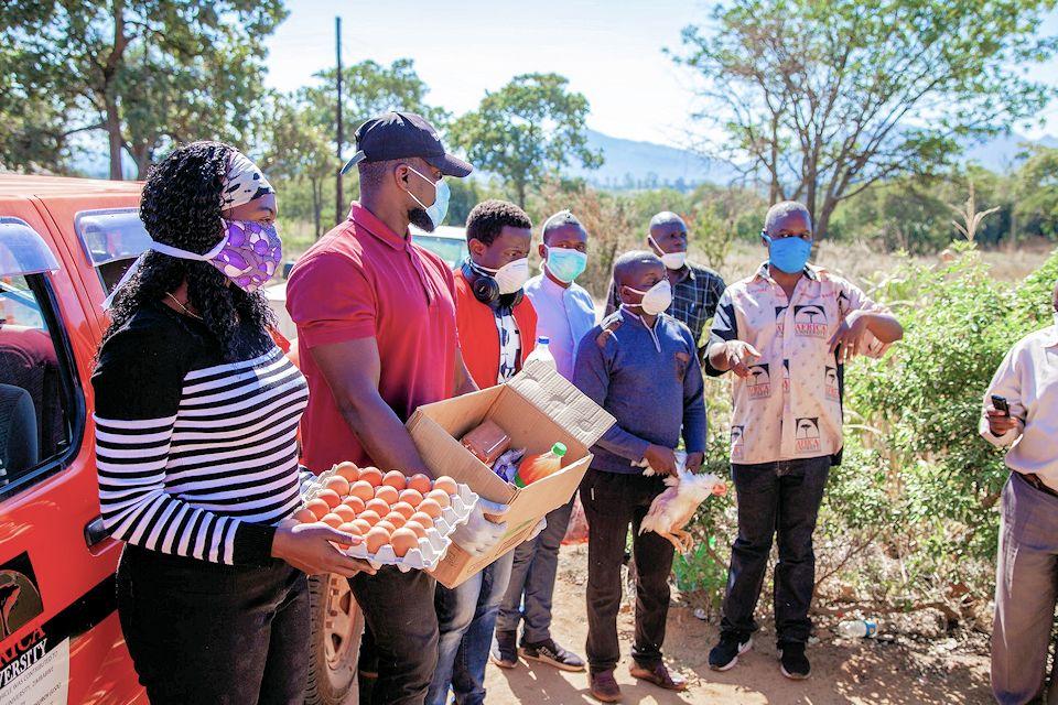 Africa U students distribute food