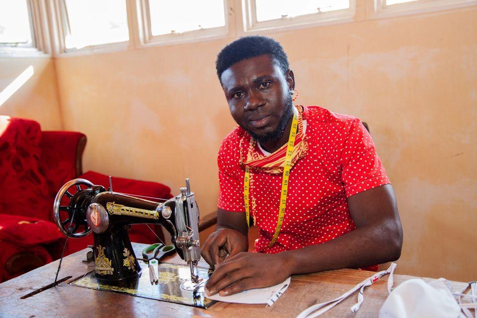 Africa U student sews