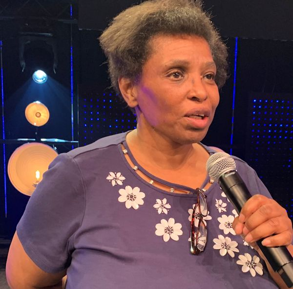 Liturgist Rev. Dr. Margie speaking of sowing