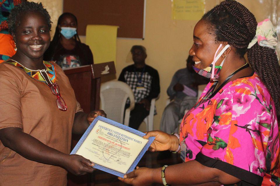 Women receive certificate