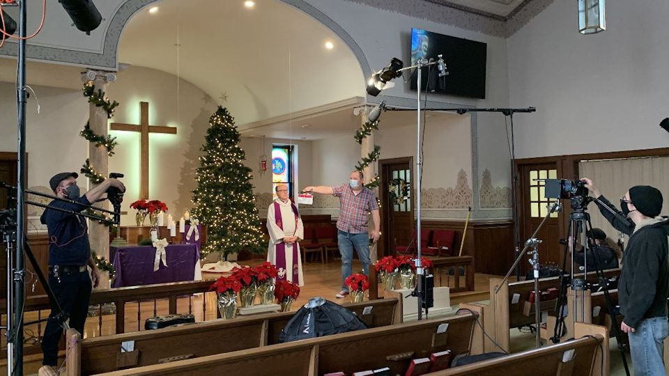 Bishop Bard taping the Dec. 24th Service.