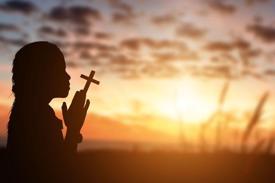 Girl praying at Easter