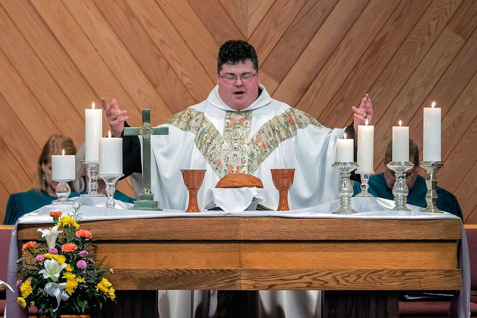 Rev. Derek Kubilus offers Christ over Q