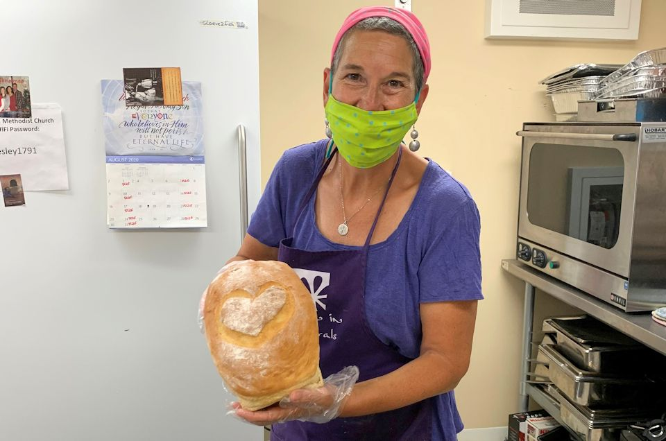 A deaconess makes bread
