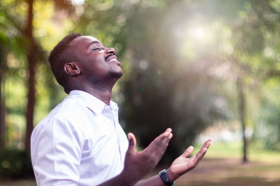 Man giving praise for new day