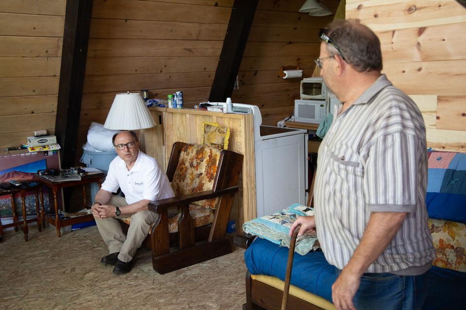 Bishop Bard with flood survivor Bill