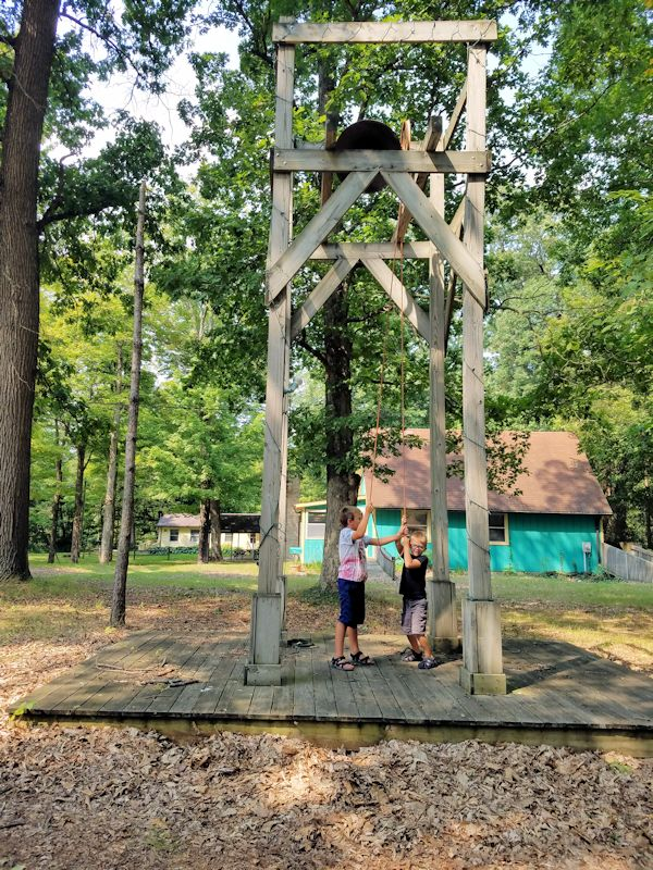 Camp bell rung by two small boys