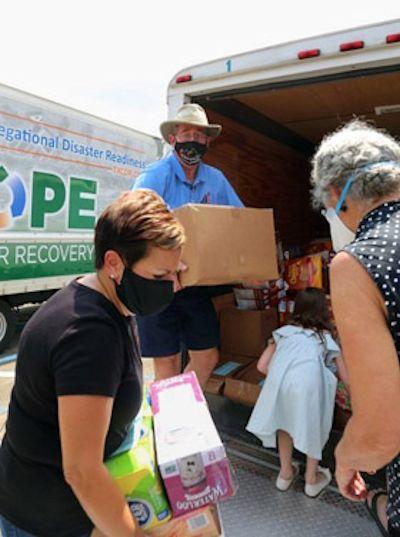 Bishops help with Ida clean-up