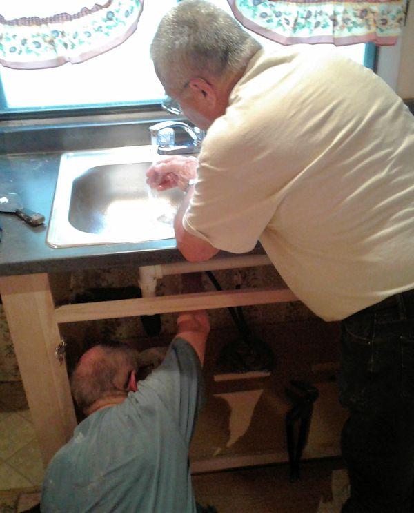 UM Men work on plumbing
