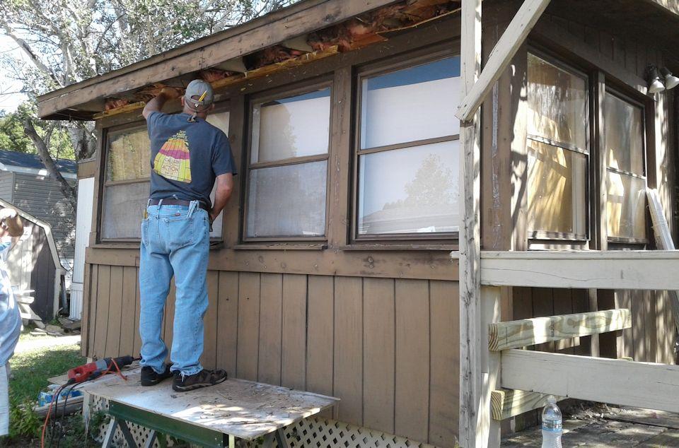 UM Men work on trailer home